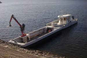 Remorkér s tlačeným pontonem na Orlíku. Autor: Zdopravy.cz